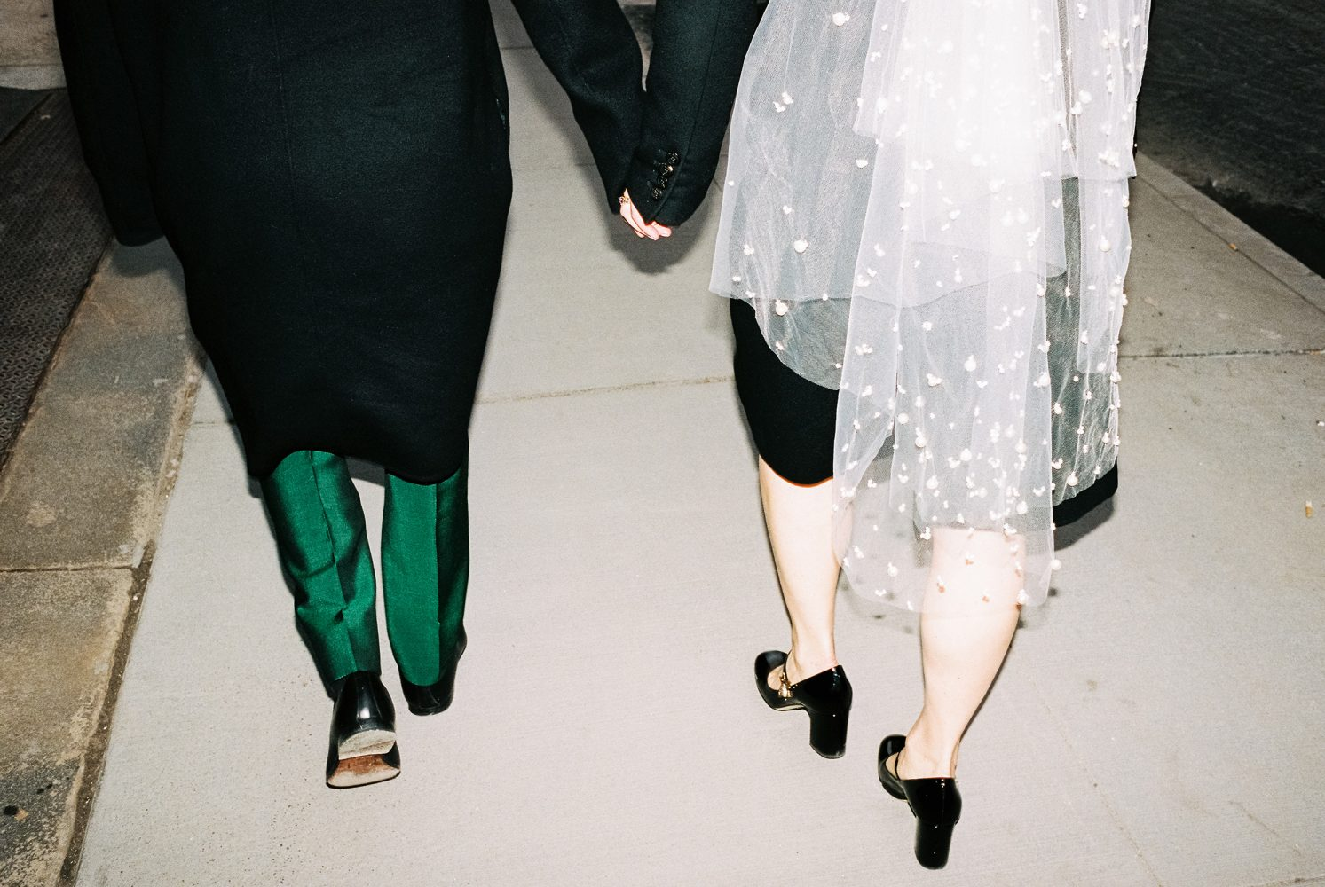 bride and groom walking in Manhattan ONONA New York wedding photographer film