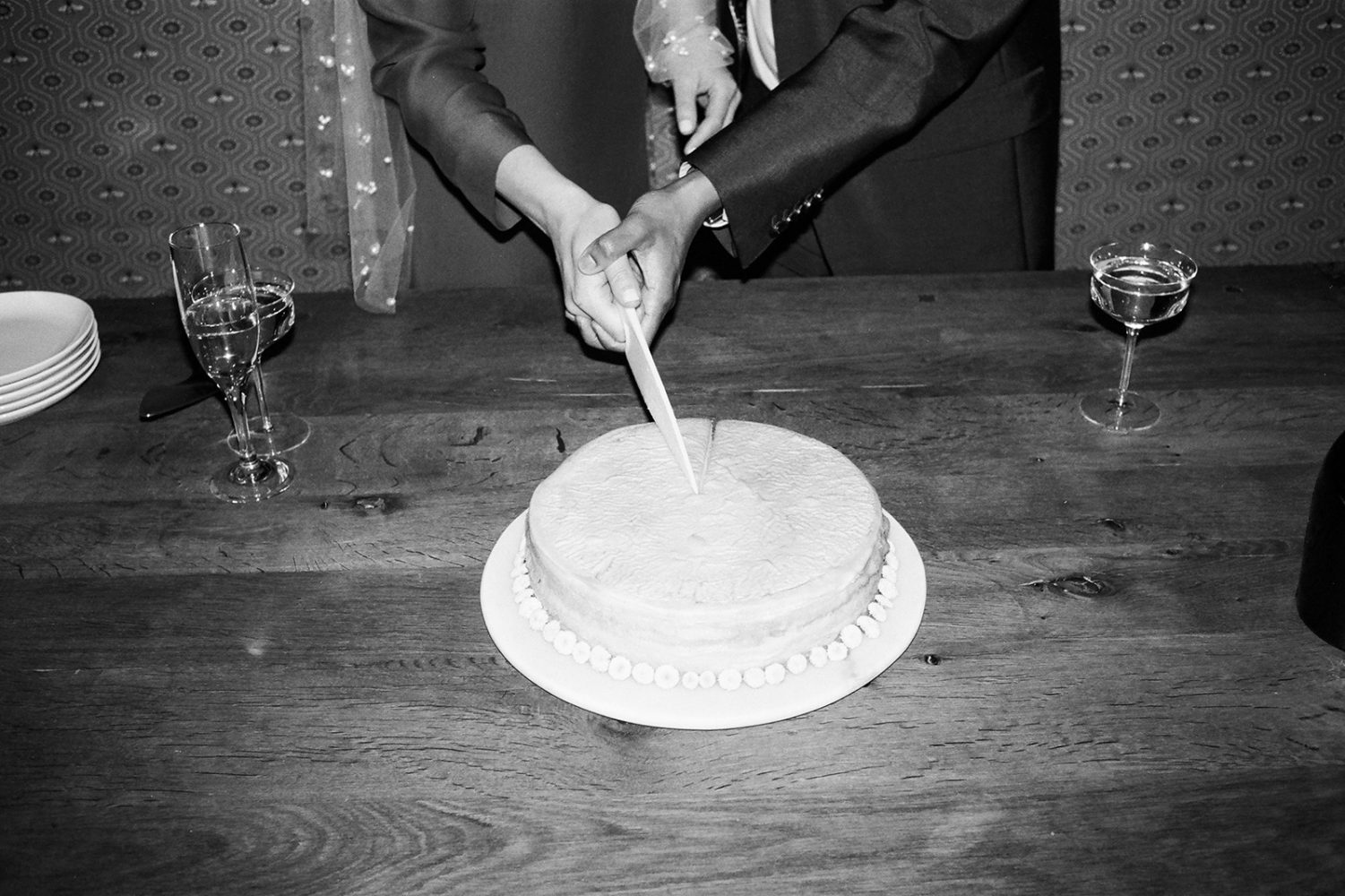 bride and groom cutting the cake ONONA New York wedding photographer film