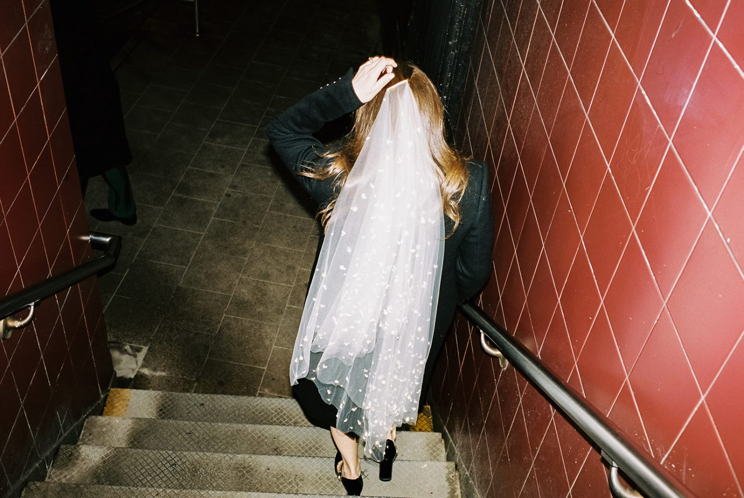 bride with veil walking in subway ONONA New York wedding photographer film