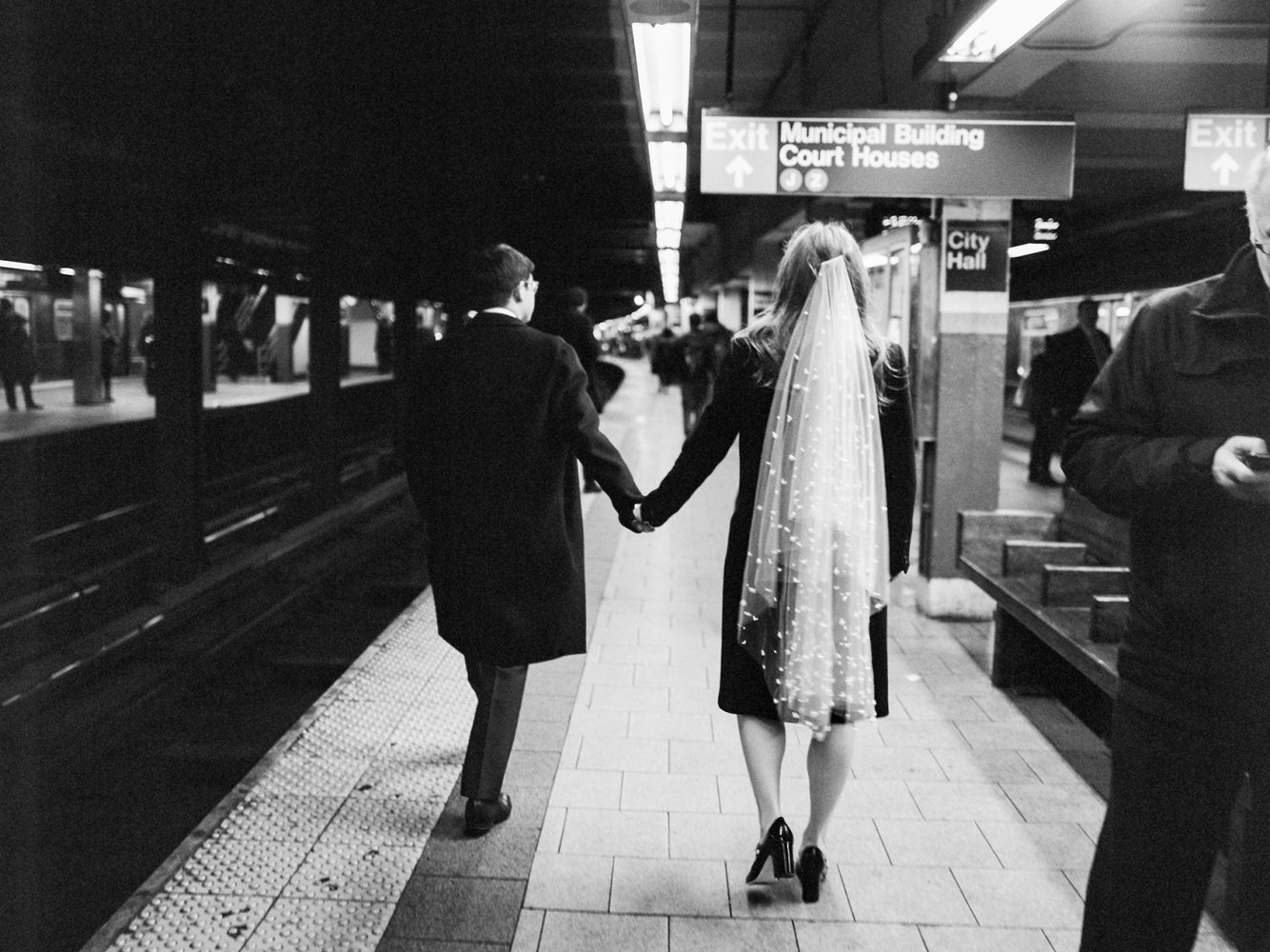 bride and groom in the subway ONONA New York wedding photographer film