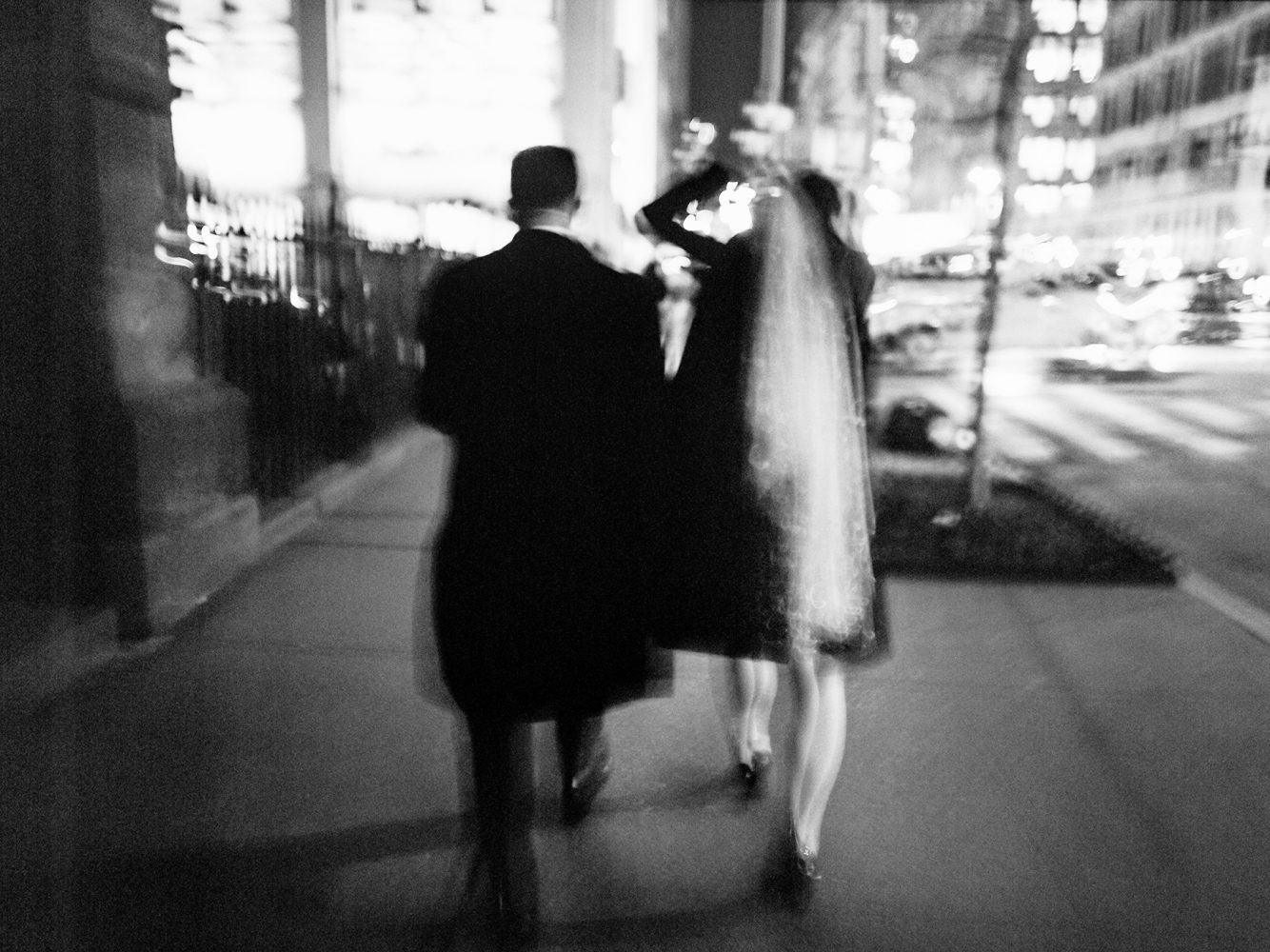 bride and groom walking at night in manhattan ONONA New York wedding photographer film