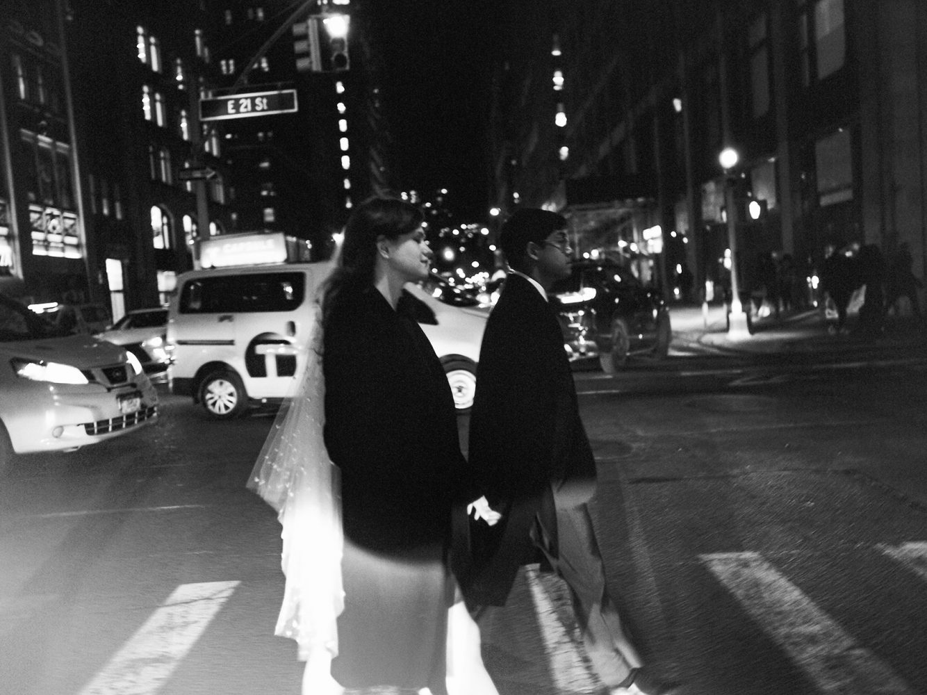 bride and groom crossing street at night NYC ONONA New York wedding photographer film