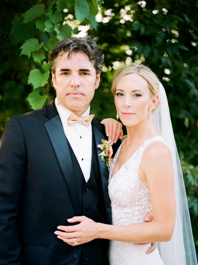 Genna and Billy, the bride and groom, in Loring Park Minneapolis, photographed with a Pentax 645m with Portra 400 film, developed by The Find Lab, wedding at Bar Lurcat, Minneapolis | ONONA Minneapolis film wedding photographer