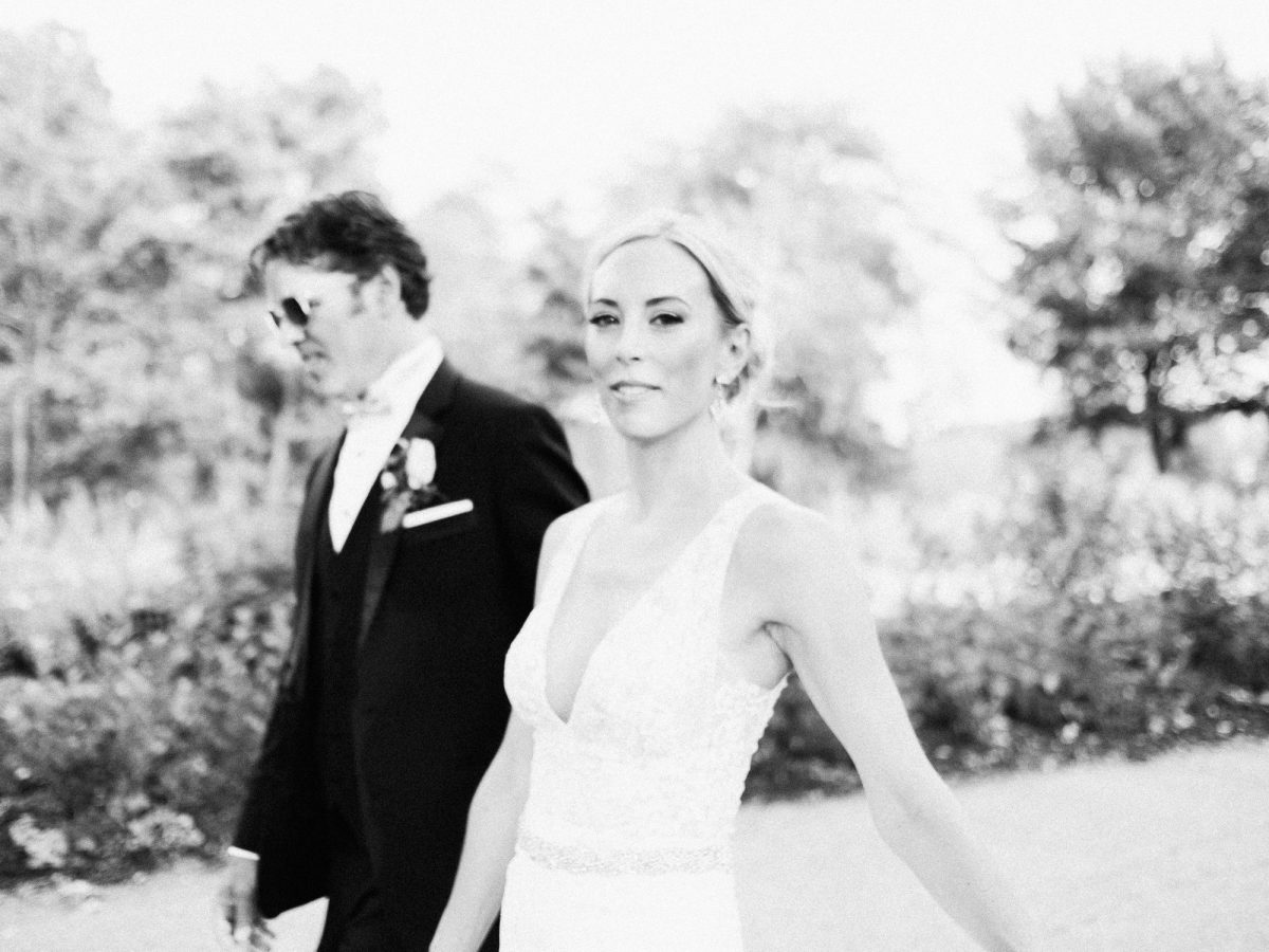 Bride and Groom walking through Loring Park, Minneapolis, Bar Lurcat wedding | ONONA Minneapolis wedding photographer
