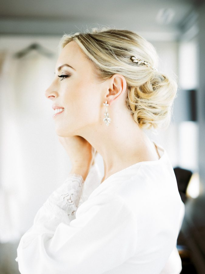 Genna putting on her earrings, wedding at Bar Lurcat, Minneapolis | ONONA Minneapolis film wedding photographer