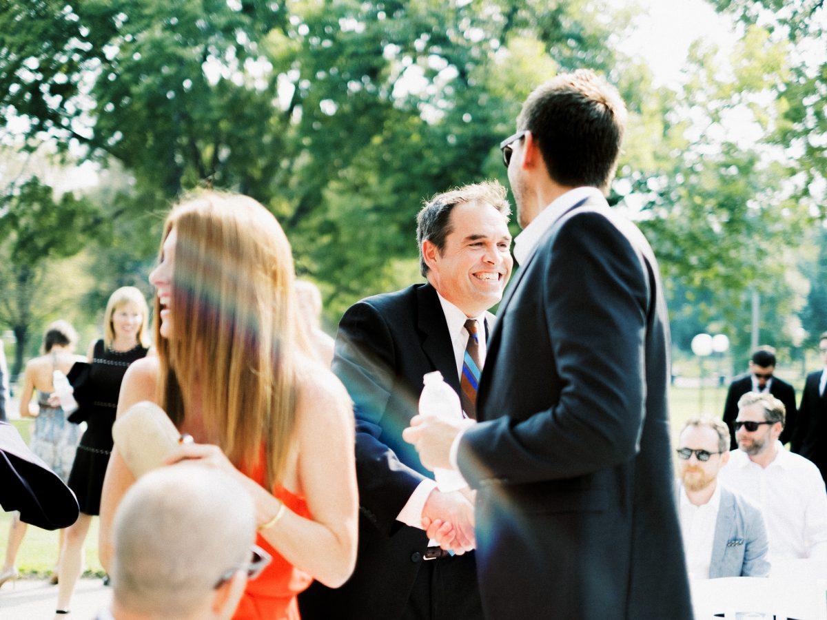 Guests arriving to wedding ceremony in Loring Park, Minneapolis, wedding at Bar Lurcat, Minneapolis | ONONA Minneapolis film wedding photographer